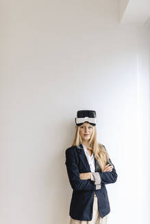 Portrait of young businesswoman wearing VR glasses - GUSF03256