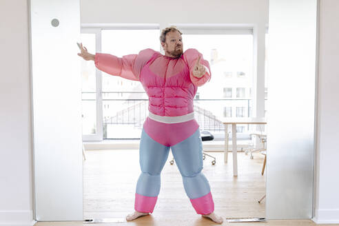 Bouncer in office wearing pink bodybuilder costume - GUSF03289