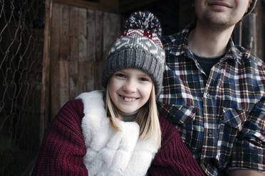 Portrait of smiling girl with her father outdoors in winter - EYAF00883