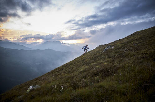 Man running uphill in the mountains - CVF01532