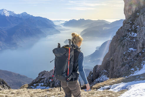 Woman hiking in the mountains at Lake Como, Italy - MCVF00188