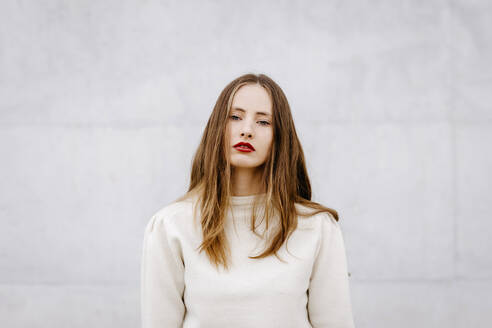 Close portrait of pretty woman with loose hair on white urban background - TCEF00060