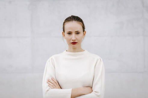 Close up portrait of pretty woman with hair bun over white urban background - TCEF00063