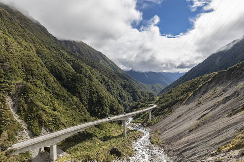 New Zealand, Selwyn District, Arthurs Pass, Otira Viaduct stretching along forested valley - FOF11524