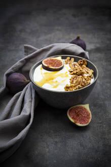 Bowl of Greek yogurt with honey, walnuts and sliced fig - LVF08560