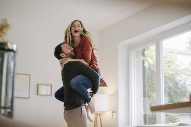 Man lifting and embracing his cheering wife - KNSF07296