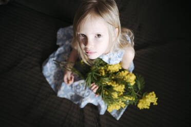 Portrait of blond little girl with bunch of mimosa - EYAF00909