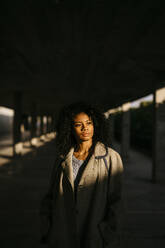 Portrait of a young woman in a parking garage - TCEF00088