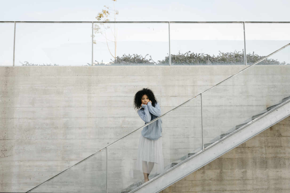Beautiful young woman standing on stairs outdoors - TCEF00094 - Tania Cervián/Westend61