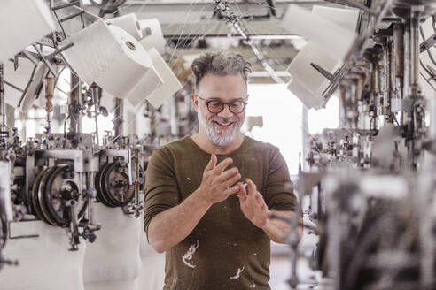 Portrait of a happy mature man in a textile factory - SDAHF00052