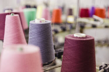Detail of multicolored cotton reels in a factory - SDAHF00055