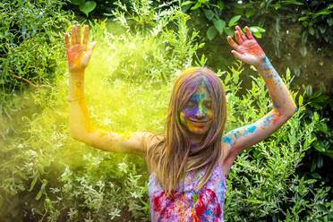 Portrait of happy girl celebrating Festival of Colours - SARF04458