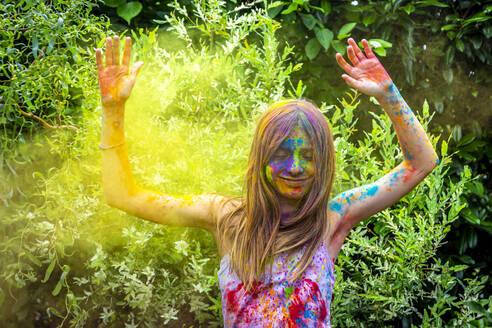 Portrait of happy girl celebrating Festival of Colours - SARF04458