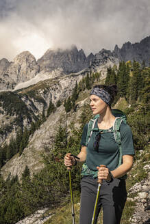 Woman on a hiking trip at Wilder Kaiser enjoying the view, Kaiser mountains, Tyrol, Austria - MSUF00163