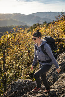 Woman hiking on rocky trail, Karlsruher Grat, Ottenhoefen, Black Forest, Germany - MSUF00181