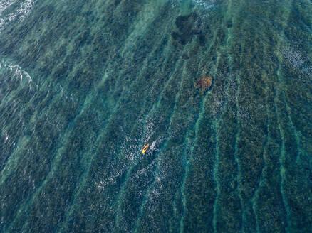 Aerial view of surfer in the ocean - CAVF74087