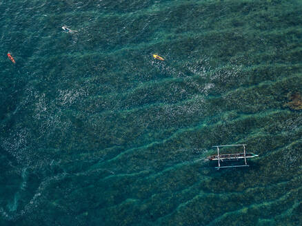 Aerial view of surfers and boat in the ocean - CAVF74108