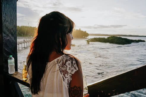 Woman watching the sunset on Siargao Island, Philippines - FAF00085
