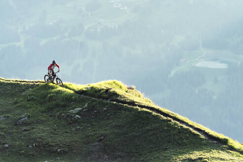 Mountainbiker on a way in Grisons, Switzerland - HBIF00009