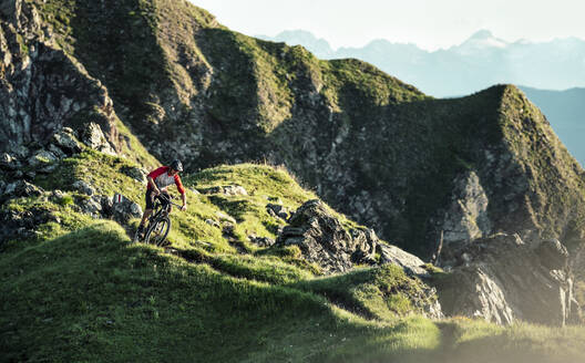 Mountainbiker on a way on a ridge, Grisons, Switzerland - HBIF00012