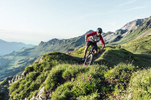 Mountainbiker on a way in Grisons, Switzerland - HBIF00015