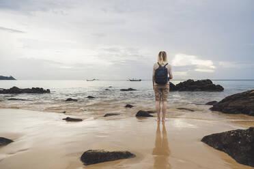 Rear view of woman on the beach Nai Thon Beach, Phuket, Thailand - CHPF00622