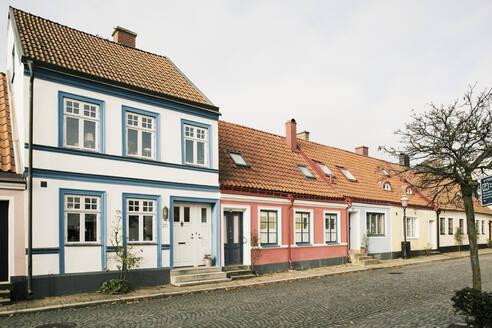 Houses along cobblestone street - JOHF07559