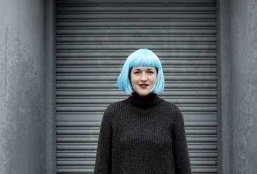 Young woman wearing blue wig - FLLF00384