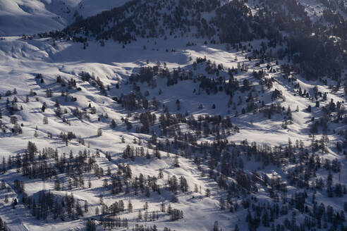 France, Hautes-Alpes, Vars, Aerial view of snow covered valley - DAMF00266