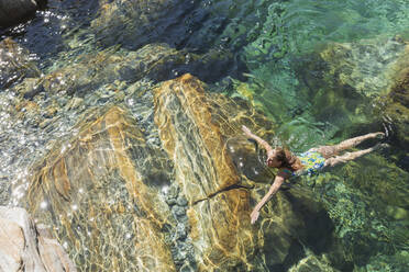 Woman swimming in refreshing Verszasca river - GWF06421