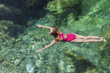 Woman swimming in refreshing Verszasca river - GWF06424