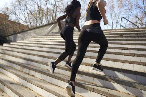Two sportswomen during workout on stairs - PACF00188