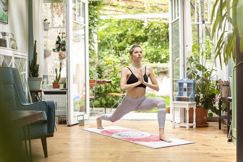Young woman practicing yoga at home - PESF01773