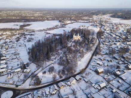 Russia, Leningrad Region, Tikhvin, Aerial view of Tikhvin in Winter - KNTF04374