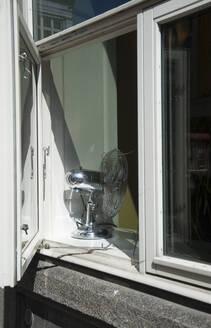 Ventilator standing on window sill - GISF00522