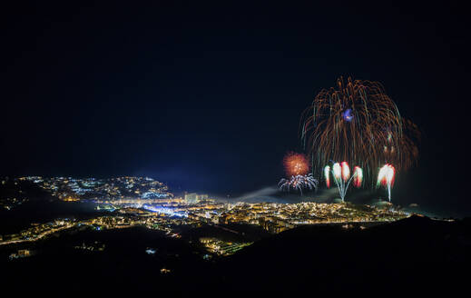 Spain, Granada, Almunecar, Illuminated city and fireworks at night  - LJF01301
