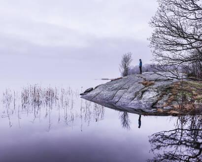 Person at lakeshore - JOHF08217