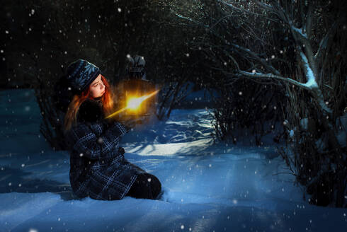 Pretty redhead girl holding lantern in winter forest - CAVF74683