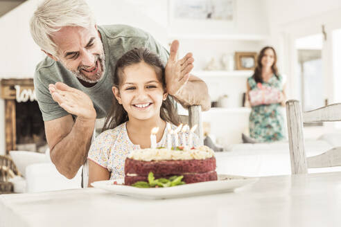 Father and mother celebrating daughter's birthday - SDAHF00233