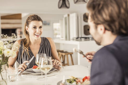Portrait of young woman having dinner with boyfriend - SDAHF00299