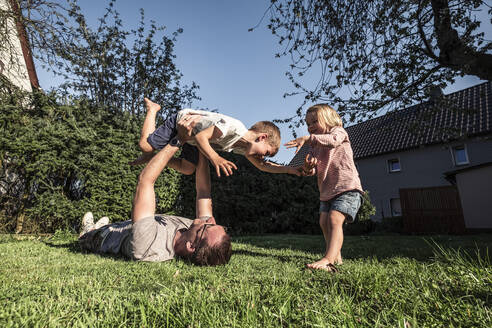 Father playing with his two kids in the garden - WFF00259