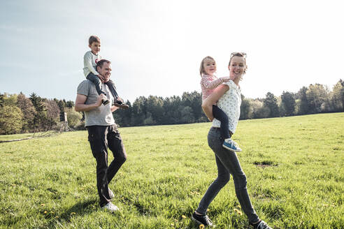 Happy family with two kids on a meadow in spring - WFF00277