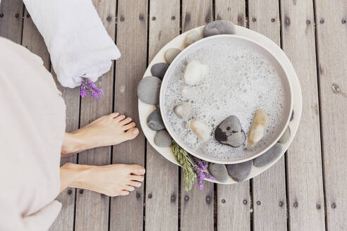 Close-up of woman's feet next to bowl with water - SDAHF00521