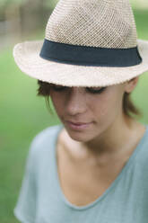 Portrait of a young woman wearing a hat - GIOF07996