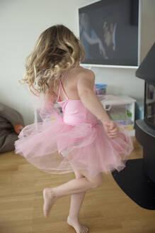 Girl wearing pink tutu dress dancing - JOHF09076