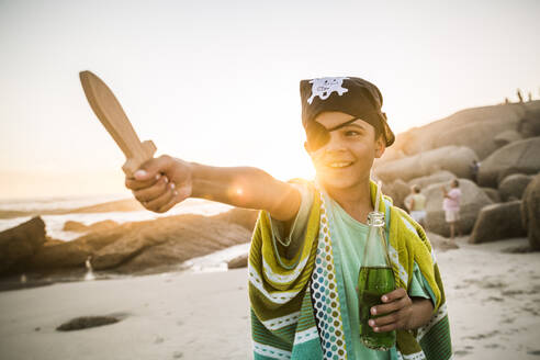 Boy dressed up as pirat on the beach at sunset - SDAHF00625
