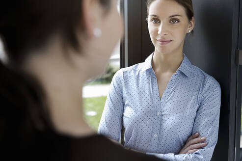 Portrait of businesswoman meeting colleague in office - BMOF00189