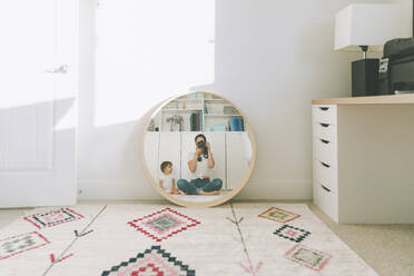 Reflection of mother taking a photograph of herself and baby in the mirror - CMSF00082