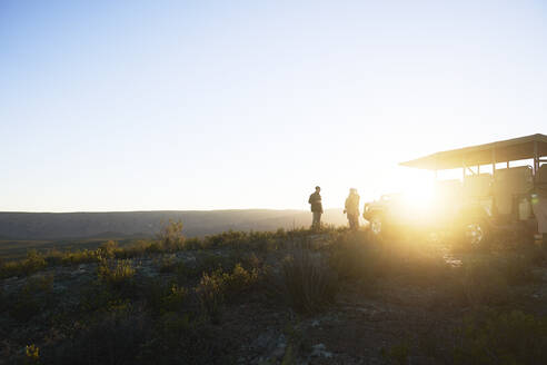 Safari tour group on sunny hill at sunrise South Africa - CAIF24024