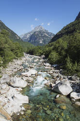 Stones and rocks in clear turquoise waters of Verzasca river, Verzasca Valley, Ticino, Switzerland - GWF06461